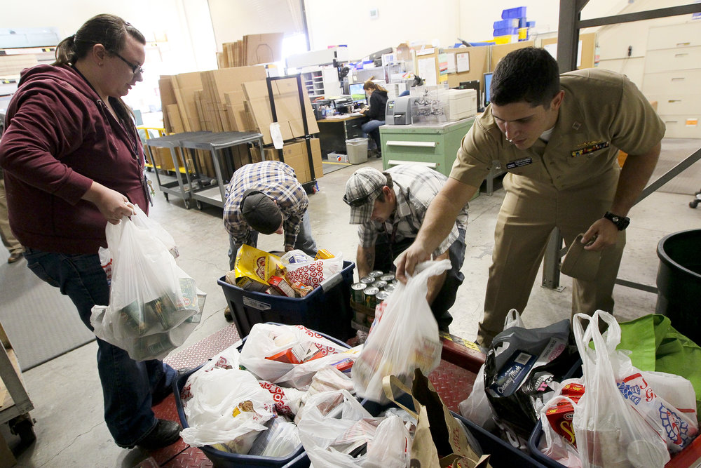 US_Navy_111123-N-HW977-185_Sailors_weigh_Thanksgiving_food_drive_donations_before_delivery_to_the_Corona-Norco_Settlement_House.jpg