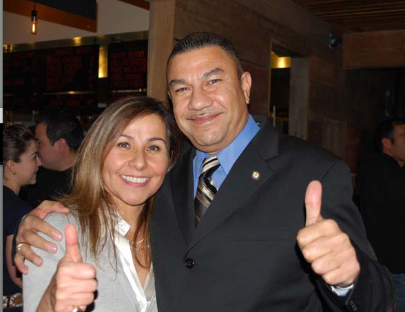 "OLA co-founder Isabel Sepulveda-de Scanlon and Assemblyman Philip Ramos (6th District) show a ""thumbs-up"" for the outpouring of support for OLA and OLA YG."