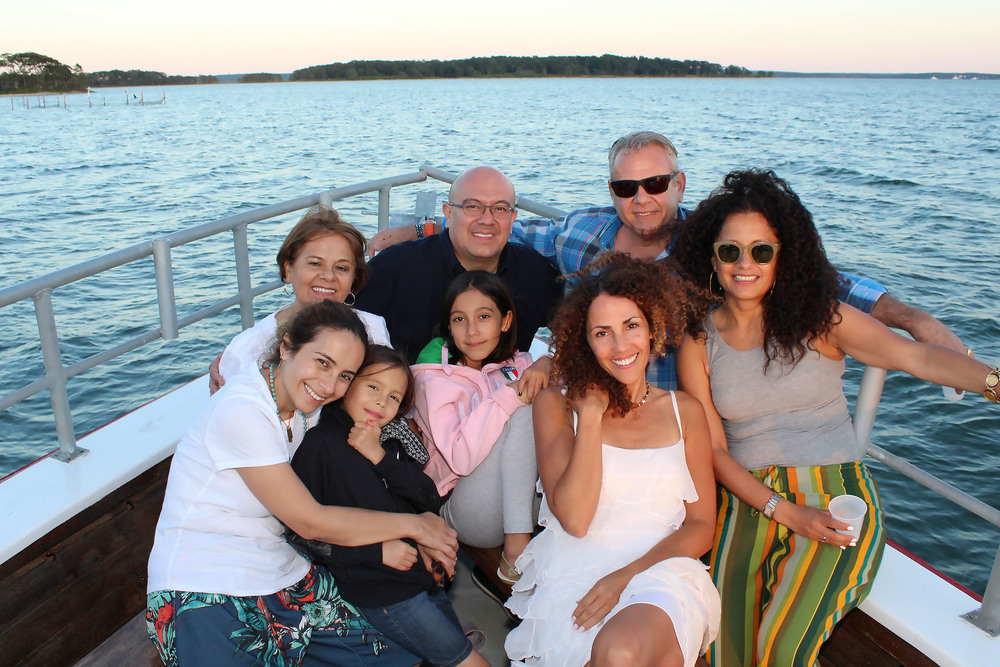 Attachment-1.jpeg OLA committee members: Elena Krotman and Jose Arandia along with  Executive Director, Minerva Perez enjoy the Sunset cruise with Marta and Yuri and their family © Tom Kotchie