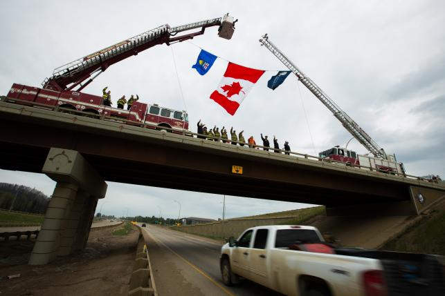 Firefighters welcoming residents back to Fort McMurray.