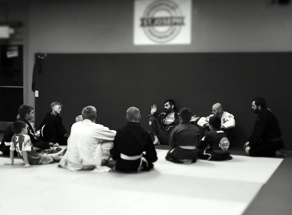 Having a discussion about it being ok to fail at things in Jiu Jitsu and life. If we continue giving our best effort everyday and trying the things we've learning in class, good things happen. Patience.
