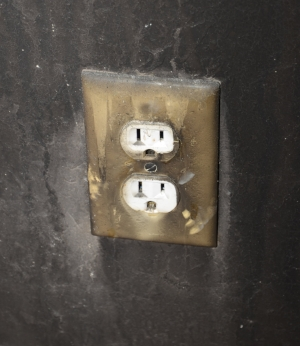 Receptacle exposed to smoke and water due to fire.