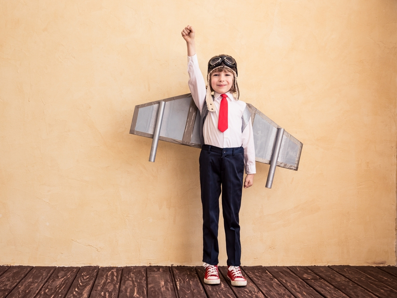stock-photo-portrait-of-young-businessman-with-toy-paper-wings-success-creative-and-start-up-concept-copy-305346131.jpg