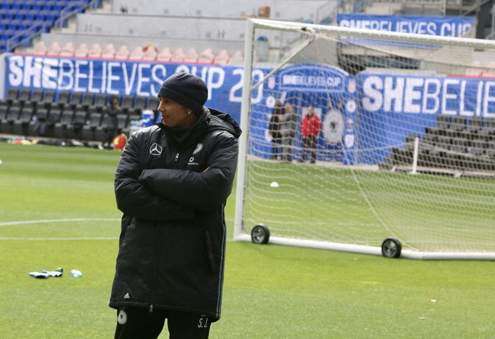 Germany's new manager Steffi Jones observes her team drills on Friday at Red Bull Arena.