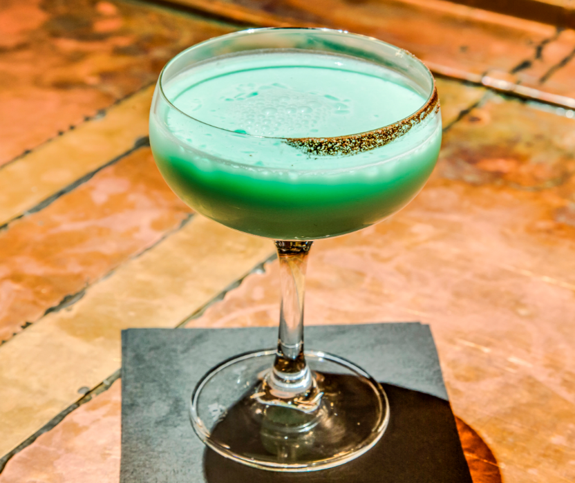 Grasshopper - Equal parts of the following:Creme de MentheWhite Creme de CacaoCream  Shake with ice and strain into a chilled cocktail glass.