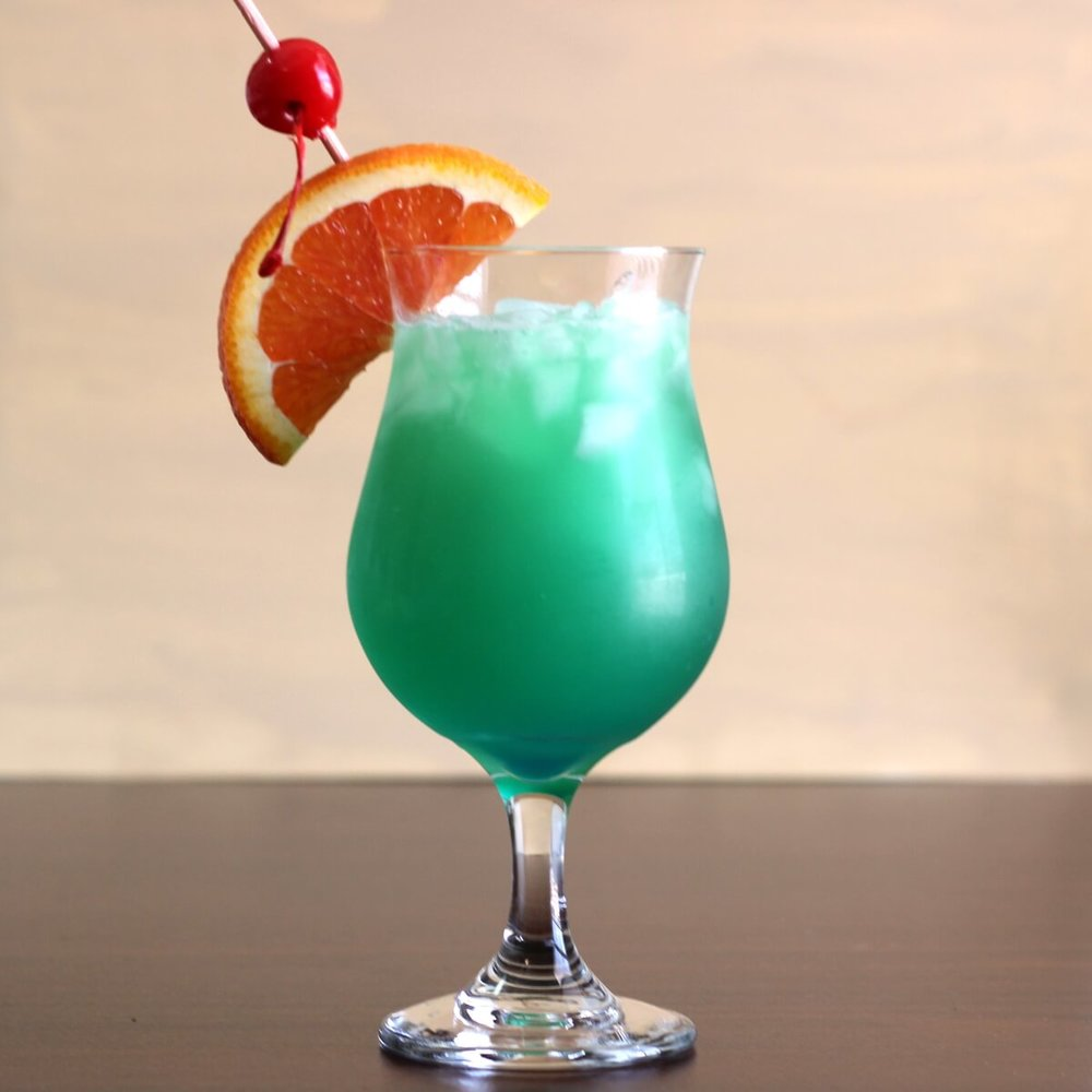 Shamrock Juice Cocktail - 1/2 ounces gin1/2 ounces white tequila1/2 ounces light rum1/2 ounces vodka1 ounce Blue Curacao4 ounces fresh squeezed orange juiceFill a hurricane or parfait glass with ice. Pour in the liquors and top off with the orange juice. Garnish with an orange wheel and cherries.