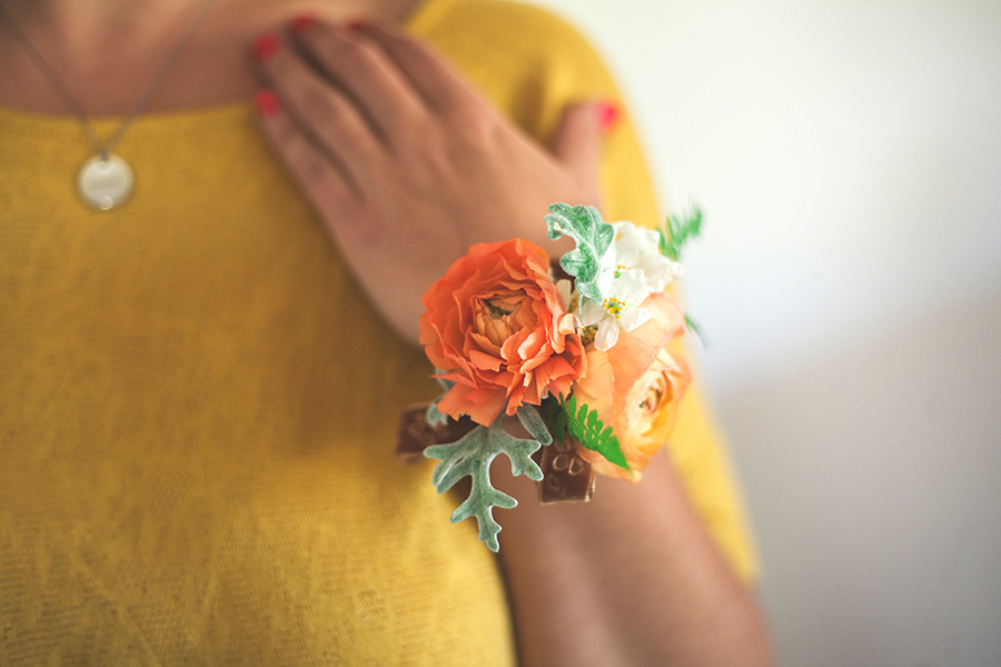 Floral Bracelet - Materials Needed: Wire, scissors, floral tape, glue, and ribbon.Flowers: Rannunculus, mock orange blossoms, dusty miller, fern leaves.Instructions: Let's Wear Flowers//Around The Wrist.