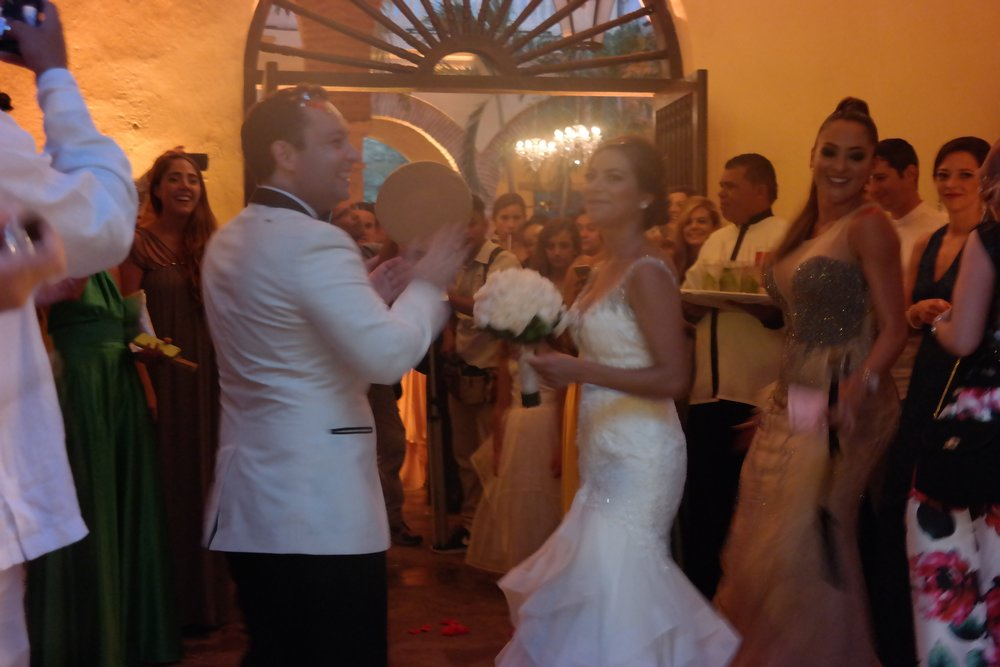 The bride & groom enter their festive reception hall in the heart of old town Cartagena.