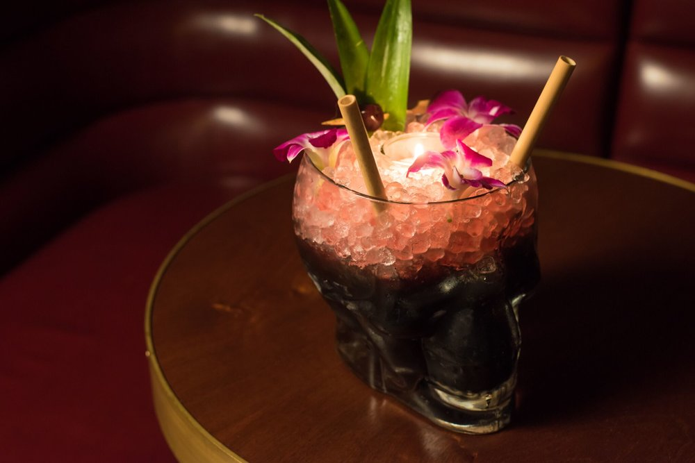Perla Negra - 2 oz. Santa Teresa 1796.5 tsp. Activated Charcoal1 oz. Kalamansi1 oz. Orange Juice.5 oz. Honey.5 oz. Ginger1 oz. ArrackTop: 2 oz. SorrelAdd activated charcoal to shaker. Add the rest of the ingredients, except the sorrel. Shake with about three large ice cubes. Strain over crushed ice into vessel. Pack a lit votive candle into the crushed ice on top of the cocktail. Measure and pour the sorrel around the candle.