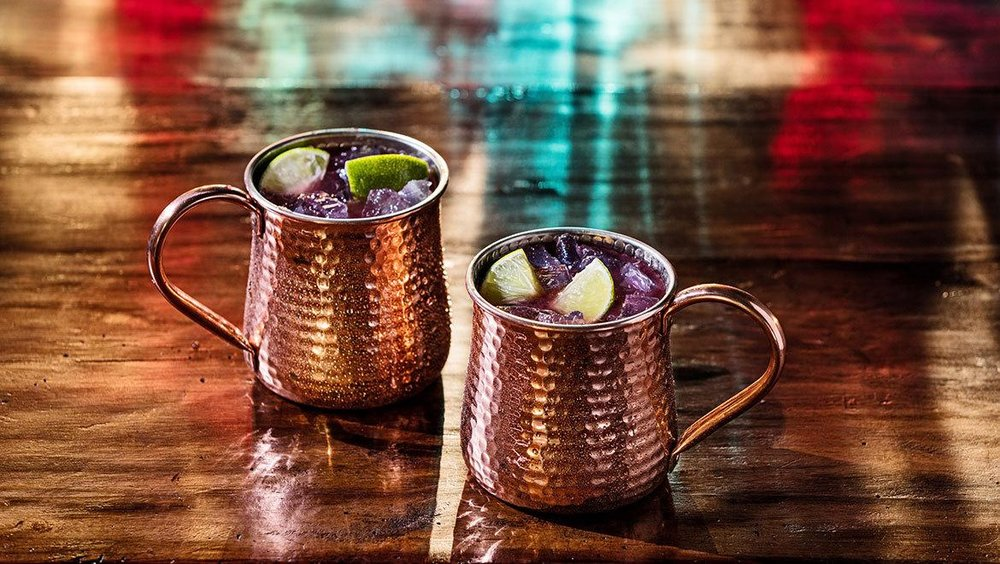 True Blue Mule - 1.5 oz. Tito's Handmade Vodka.75 oz. Blueberry Real Infused Syrup4 oz. Ginger BeerHalf LimeIn a cocktail shaker, squeeze a half of a lime into a glass and drop lime into glass. Add the Reàl Infused Syrup and Tito's Handmade Vodka. Top with ice and shake vigorously. Add the ginger beer and roll contents. Pour into a copper mug.