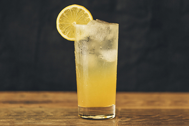 The Hillary - 2.5 oz. Gin1.5 oz. Freshly Squeezed Lemon Juice.5 oz. Peach Liqueur.5 oz Honey SyrupSoda WaterGarnish: Lemon WheelPour all of the ingredients except the soda water into an ice-filled Collins glass, stir, and top with the soda water. Garnish with a lemon wheel.*Honey syrup: Heat equal parts honey and water in a small saucepan, and stir until the honey is completely dissolved. Cool and store refrigerated for up to 1 week.