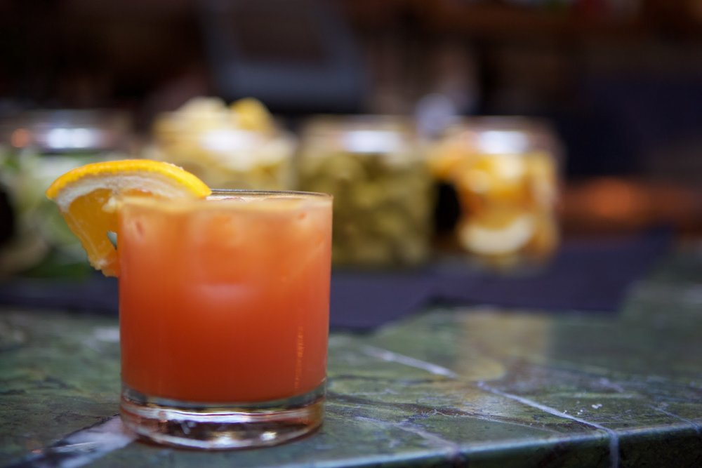 Lost In Polanco - 1.5 oz jalapeno infused Maestro Dobel.5 oz Cointreau.5 oz lime juice1 oz blood orange pureeCombine ingredients and shake. Serve on the rocks and garnish with an orange slice.