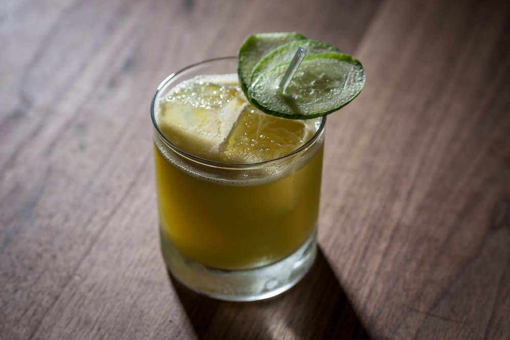 Green Dream at The LCL Bar & Kitchen - 1.5 oz Crop Cucumber vodka1.5 oz Liquiteria All Greens juice blend1.5 oz Apple juice.25 oz Lemon juiceShake and pour into rocks glass over ice. Garnish with a cucumber fan.