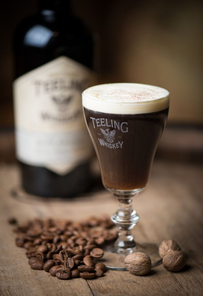 The Teeling Whiskey Irish Coffee - 1 ½ fl oz Teeling Irish Whiskey Small Batch4 fl oz Freshly Brewed, Robust Coffee½ fl oz Spiced Stout Syrup Orange Zested CreamGarnish: Freshly Grated NutmegSuggested Glassware: Hot Drinks GlassDirections: Preheat glass with some warm water and discard, add the Teeling Whiskey, stout syrup, brewed coffee and stir to combine. Warm a large spoon and gently pour the cream over the back of the spoon and on to the coffee.