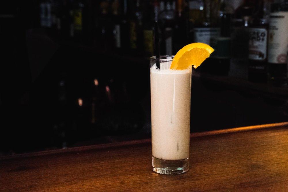 Irish Slang at Seamstress NYC - 1.5oz Teeling Single Grain Irish Whiskey 1.5oz Kerrygold Irish Cream Liqueur.75oz Borghetti Liqueur .5oz Grand MarnierDirections: Shake and strain into a highball. Garnish with an orange slice