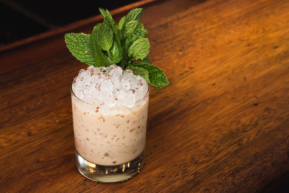 Gaelic Grasshopper at Seamstress NYC - 1.5oz Kerrygold Irish Cream Liqueur 1oz Teeling Small Batch Irish whiskey .5oz Brancamenta .5oz Creme de Cacao Directions: Shake lightly and strain over crushed ice. Garnish with mint and shaved chocolate