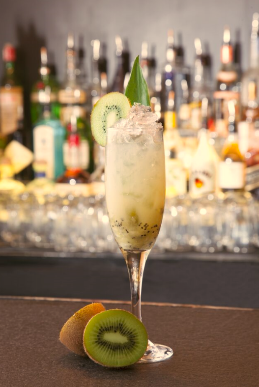 Swizzle Me Irish at Muddling Memories - 1 ½ parts Sugar Island Coconut Rum ¾ part Fresh Kiwi Puree¼ part Fresh Lemon Juice¾ part Pineapple JuiceIn a glass shaker, add all ingredients, add ice and shake and strain over crushed ice. Garnish with Kiwi wheel and a pineapple leaf.