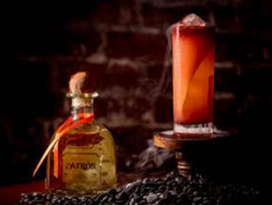 The Jimadores Paloma - 2 oz Patrón Reposado3 oz Grapefruit Juice1 oz Fresh Lime Juice1 oz Smoke Hibiscus Syrup5 dashes of Peychaud Bitters5 dashes of Angostura BittersGinger beer to fillPinch of SaltDirections:Add grapefruit, lime, salt and Patrón into shake. Add with ice and shake for 5 seconds. Straing into a Collins glass and fill with ginger beer. Pour Hibiscus Syrup on top and dash Bitters as well. Garnish with a snake Grapefruit peel inside glass.