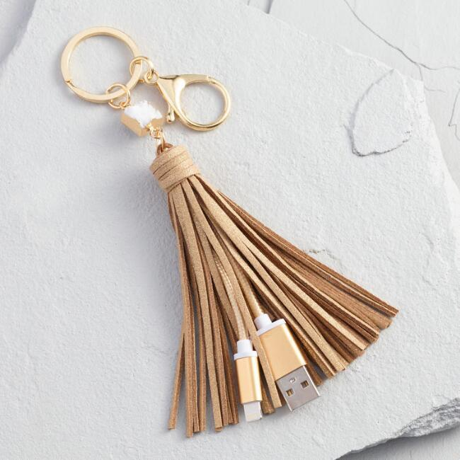 Gold iPhone Charger Tassel Keychain ($14.99) - Now your keychain can get you out of a jam (a powerless one, anyway). This sophisticated gold faux leather tassel cleverly conceals a USB-C Lightning cable adapter. Cool, right? #stayconnected