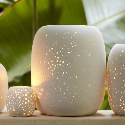 West Elm Pierced Porcelain Hurricanes + Vases - Constellation ($7-$47) - Make a statement with subtle lighting. These hurricane vases are etched with holes to create a glow like no other. #happystargazing