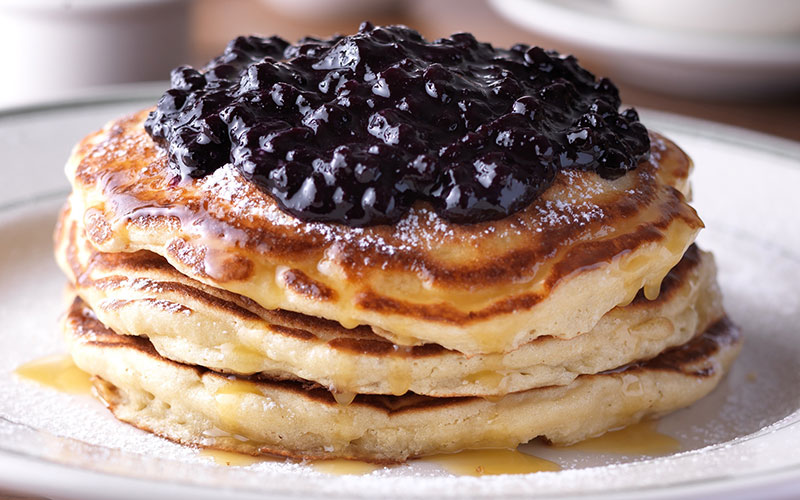 Clinton-St-Baking-Company-Restaurant-Pancakes-with-Warm-Maple-Butter-Wild-Blueberries.jpg