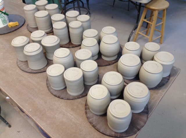 Mugs made and turned upside down to dry better. Mugs trimmed and waiting for handles.