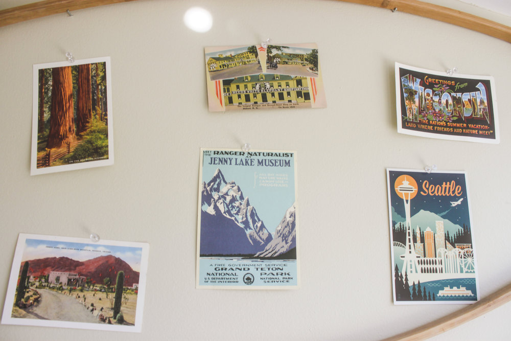 postcard collection, framed by random discarded piece of wood we found on the street