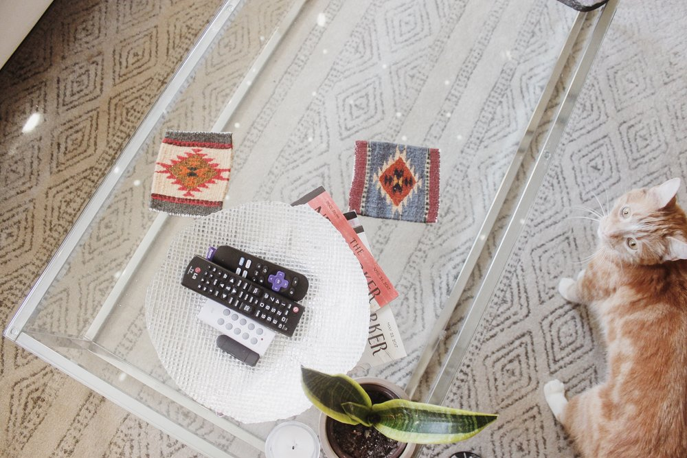 remote bowl: homegoods coasters: gift shop in austin, texas carpet: rugsUSA
