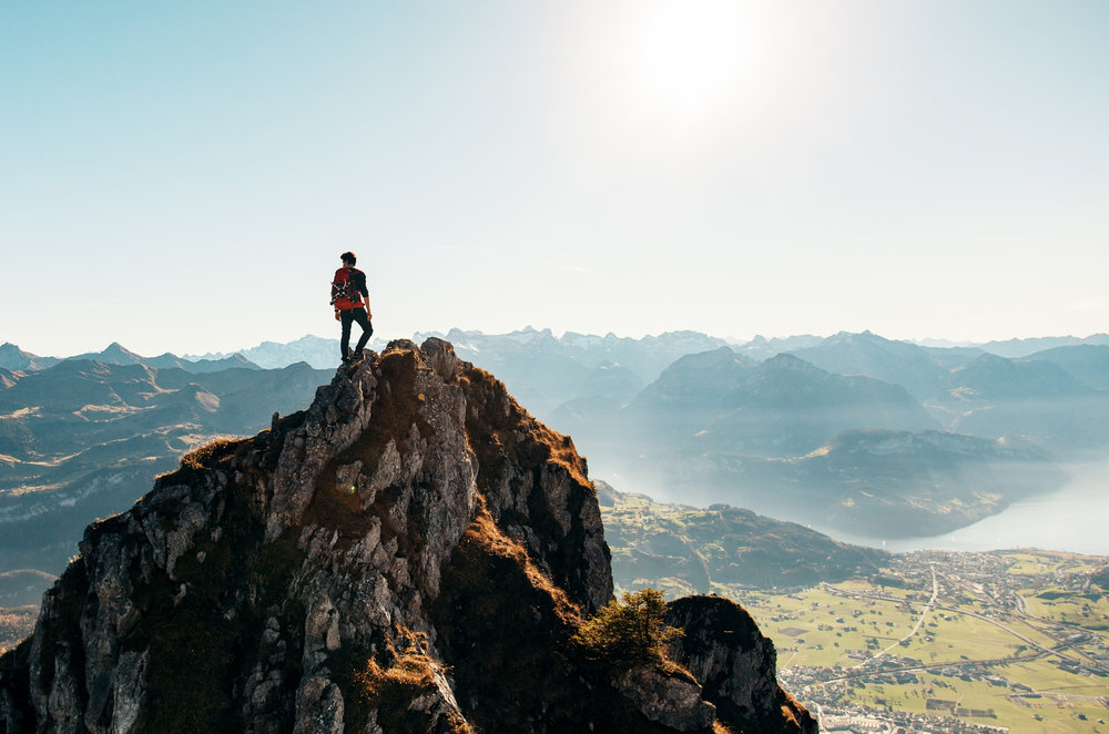 Male hiker atop mountain-Pexels.jpeg