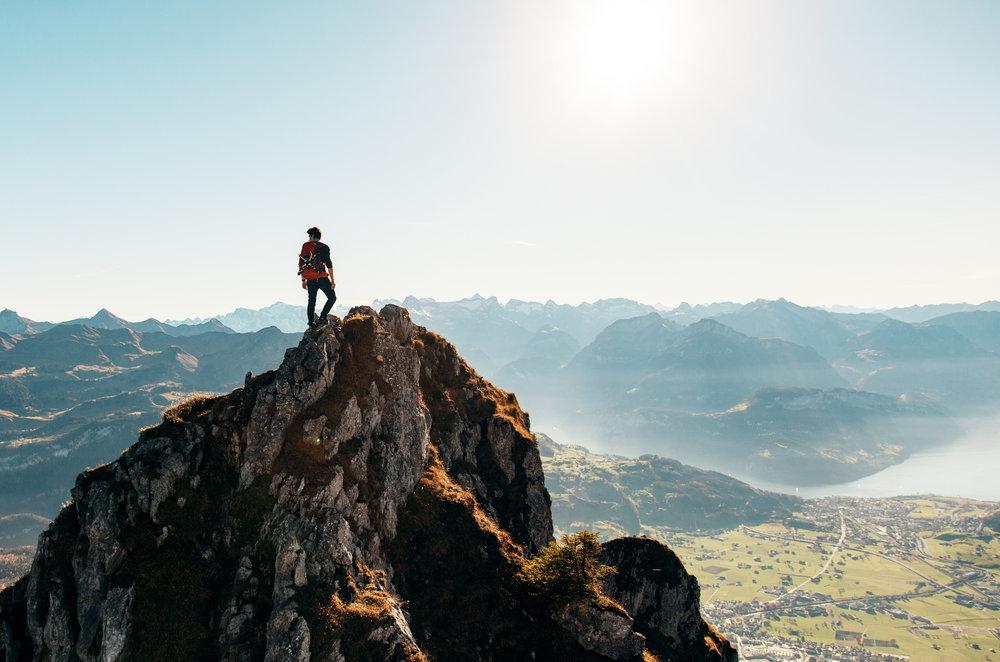 Male hiker atop mountain-Pexels.jpeg