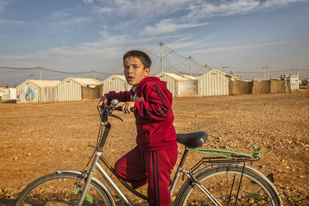 Syrian Boy on Bicycle