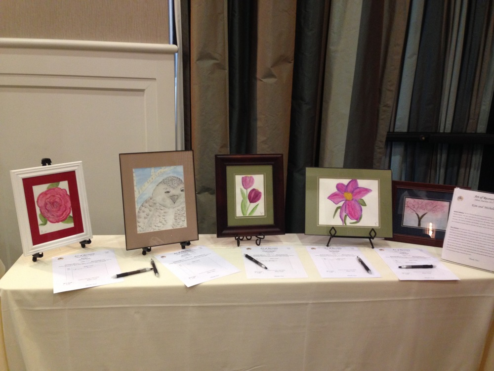 Michele's display of watercolor paintings at last year's AOR silent auction event.