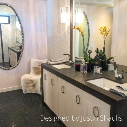 Memphis Mirror adorns the wall of this guest bath