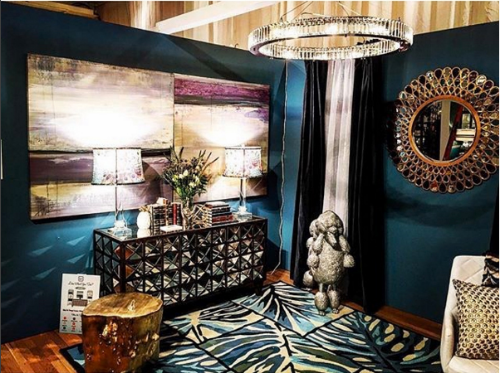 Our Mirrored Pyramid Cabinet is the perfect base to the beautiful art work. Photo taken by Justin Shaulis.