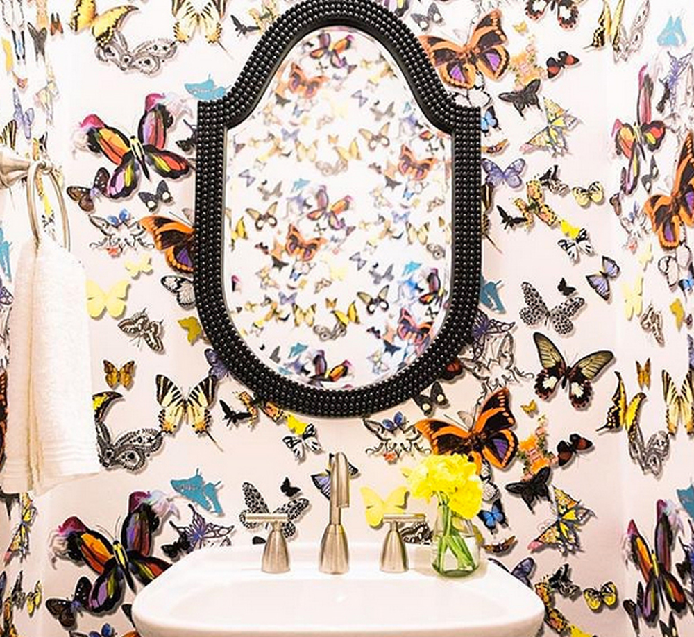 Studioten25 in Dallas sent us this gorgeous photo of a powder room with our Lancelot Mirror in Black set on this whimsical butterfly wallpaper.  Click the image to see our Lancelot Mirror in Color!