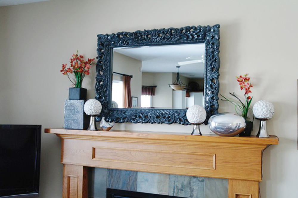 Our Barcelona Mirror is a popular Custom Color Selection. Check out this lovely mantel by Henry's Purveyor of Fine Things in Alberta, Canada! They used our Barcelona Mirror in Charcoal as a lovely statement in this room. Click the image to see our Barcelona Mirror in Color!