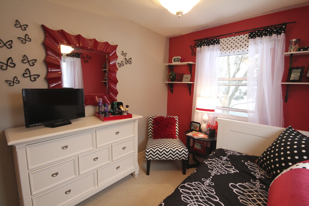 Now this mirror is no longer in our line, BUT this photo is so awesome I had to share. It comes to us from Eleni Interiors in Illinois & Michigan. They created this room as part of a Make a Wish Foundation transformation. Our Jacquelyn Mirror in Red.