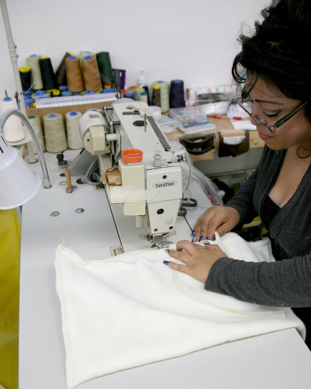 Seamstress expertly inserting an invisible zipper.