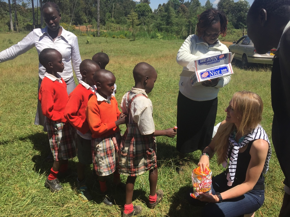 Sanna Giving candy to the orphan children