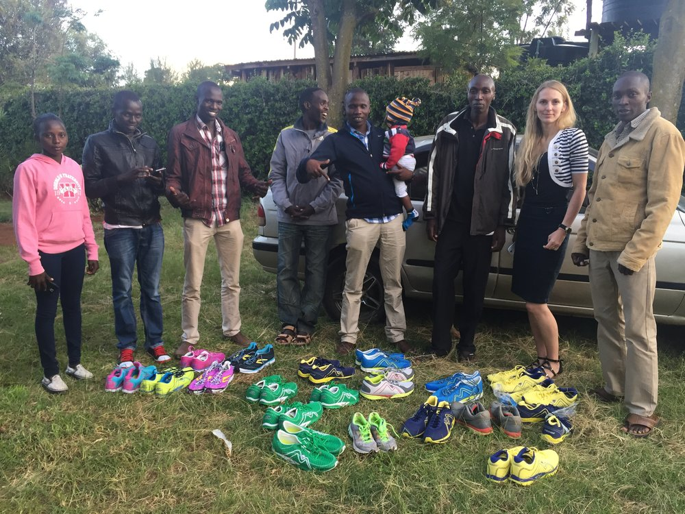 Wilson Chebet helps to distribute shoes