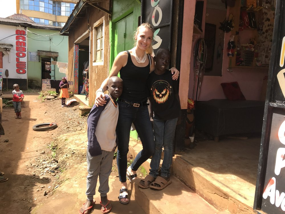 Copy of Sanna with two of the boys who are sponsored by Lee Sisters. They will live at Garden of Hope once the home is constructed.