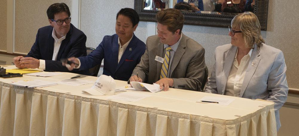(Left to right):  John Mosey (NorthstarMLS President/CEO), Man Huynh (SPAAR President), Jay Jewson (SEMR President) and Kath Hammerseng (MAAR President)