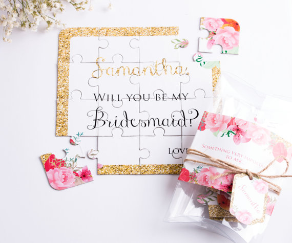 2. This puzzle is simple and sweet. This is a great idea if you have to ask bridesmaids out of state. What a fun surprise in the mail. Check out their website  here .