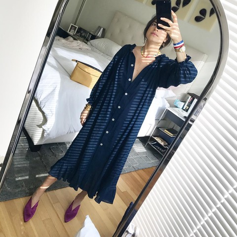 Leandra Medine wearing Sleeper Linen Dress in Navy
