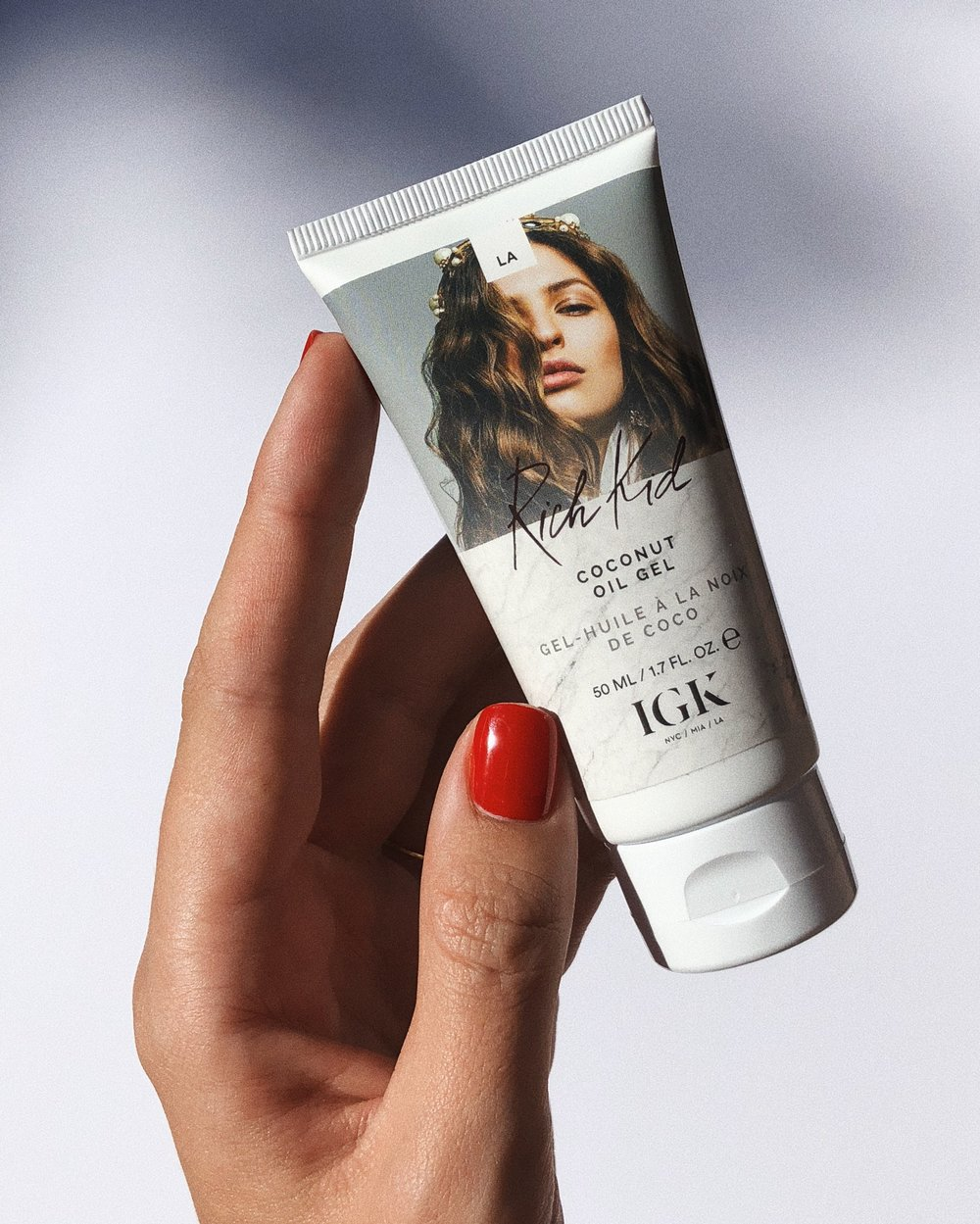 IGK - Coconut Oil Gel. Smells like a beach vacation! You apply it on wet hair to create a messy look. I have super fine hair and just a tiny drop of it on the ends is enough to create some texture without making my hair look dirty or too dry. Interesting product, nothing I ever tried before.
