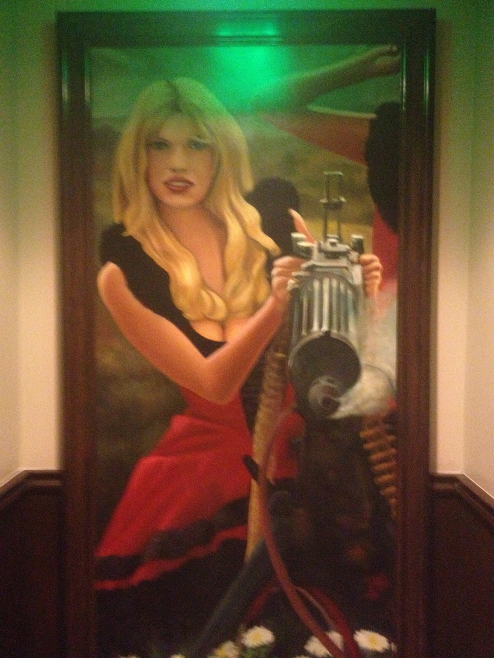 Blonde with Gatling gun. Only in a Vegas restaurant…