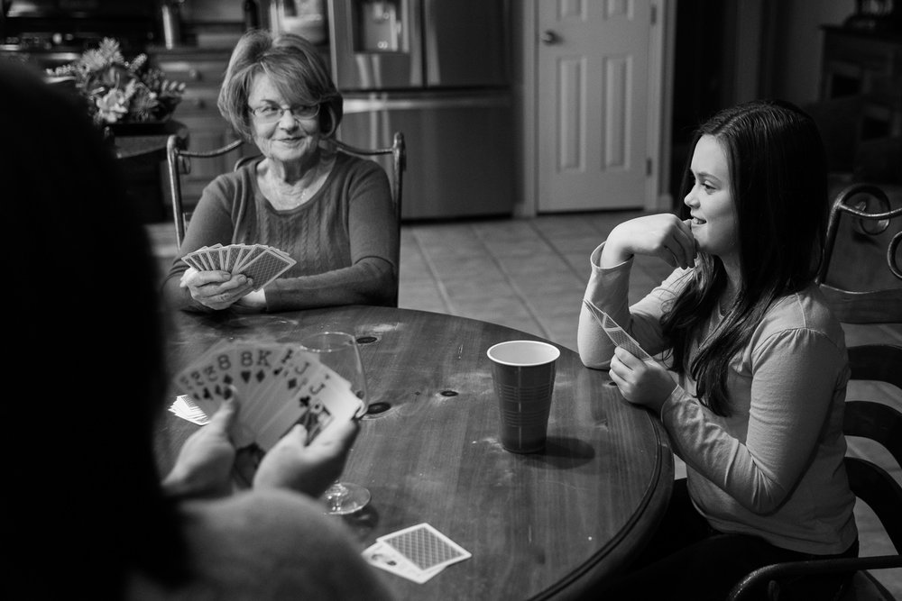 Four generations of women play cards during their family documentary session in Kent County Maryland