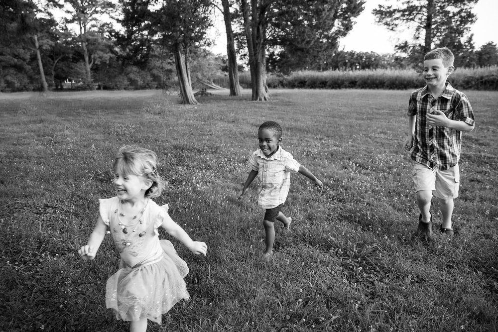 Little cousins running one summer evening on the Eastern Shore of Maryland