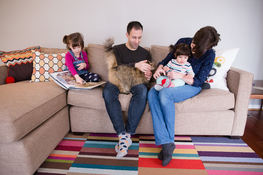 A family on their sofa during a relaxing photo session in their Maryland home