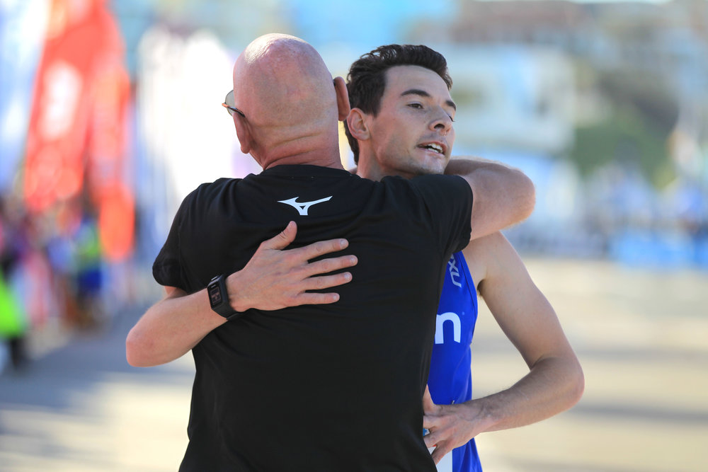Jim and Harry hugging it out after Harry won City2Surf in 2017.